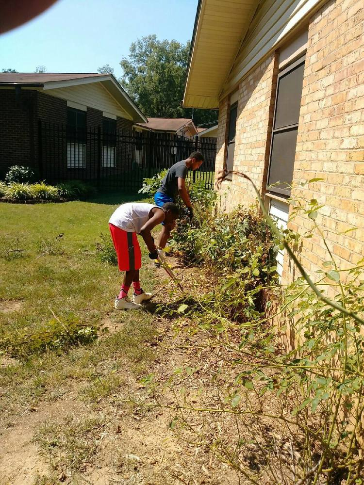 resident youths working on landscaping
