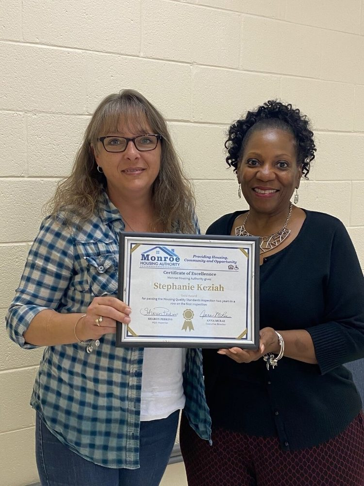 Stephanie Keziah  with gold certificate of excellence