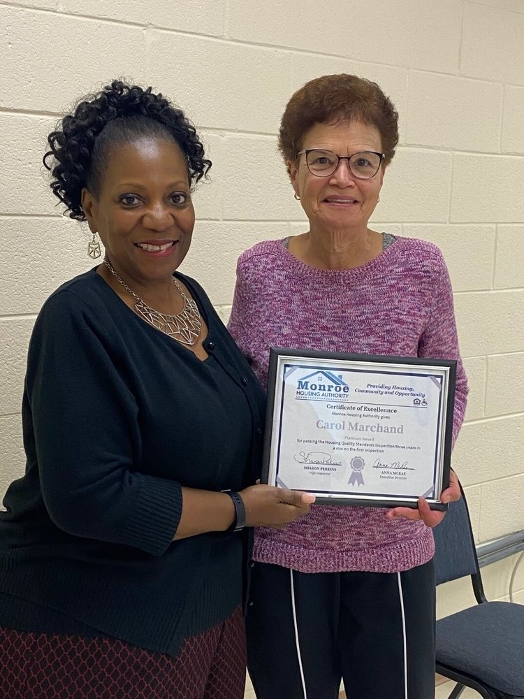 Carol Marchand with platinum certificate of excellence