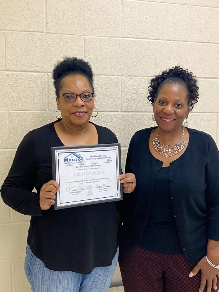 Eula Covington with certificate of excellence